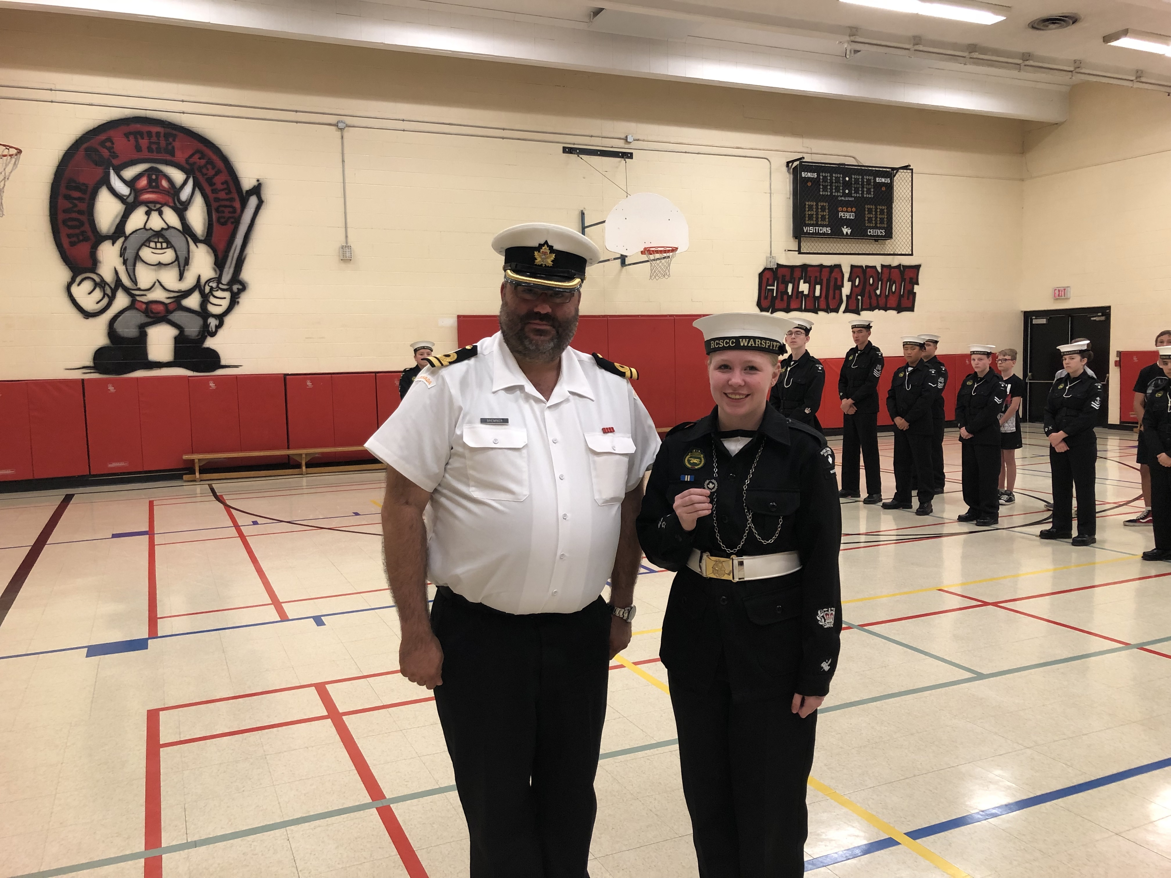 CPO2 Burt receives her staff badge